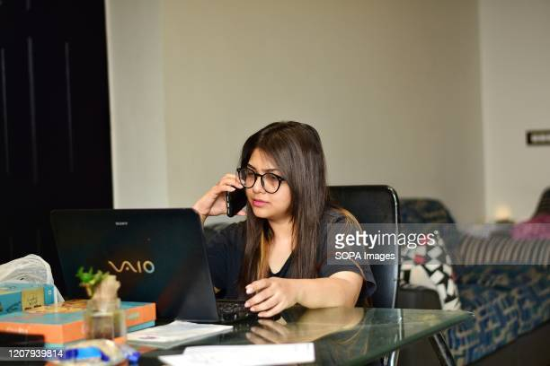 In this photo illustration a female service employee working in Delhi and living in Noida works from home With a rise in cases of Coronavirus delhi...