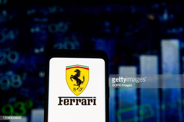 In this photo illustration a Ferrari logo seen displayed on a smartphone