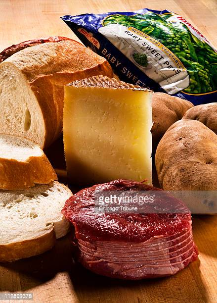 In this photo illustration a few food items considered by some people as not healthy include white bread red meat cheese potatoes and frozen...
