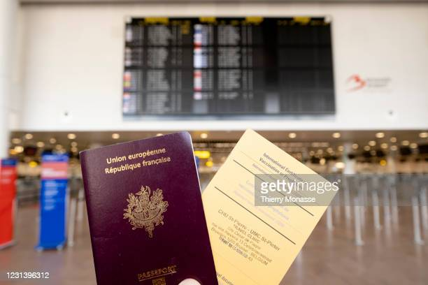 In this photo illustration, a French passport and an International Certificate of Vaccination or Prophylaxis are shown in front of the travel...