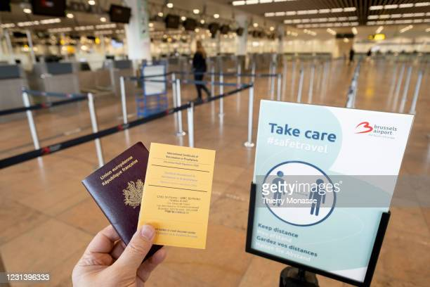 In this photo illustration, a French passport and an International Certificate of Vaccination or Prophylaxis are shown in the nearly empty Brussels...