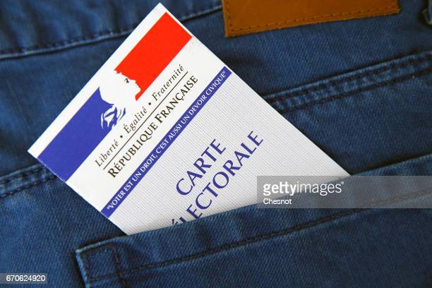 In this photo illustration a French voter registration card for the 2017 French presidential elections is seen In the pocket of a trouser on April 20...