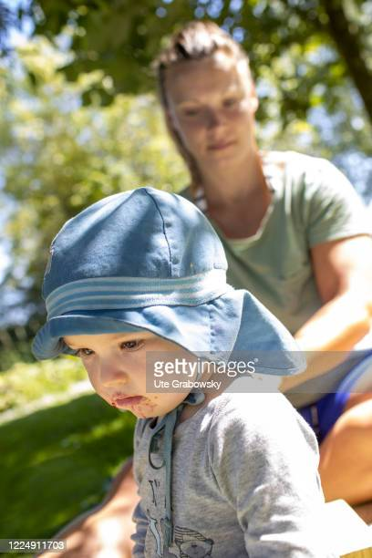 OOSTKAPELLE NETHERLAND JUNE 22 In this photo illustration a frustrated child turns away from its mother on June 22 2020 in Oostkapelle Netherlands