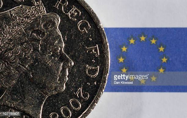 In this photo illustration a GBP1 coin sits on a 5 Euro note on November 26 2010 in London England Concerns over the Euro zone debts have caused...