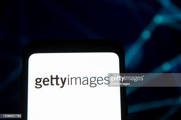 In this photo illustration a Getty Images logo seen displayed on a smartphone.