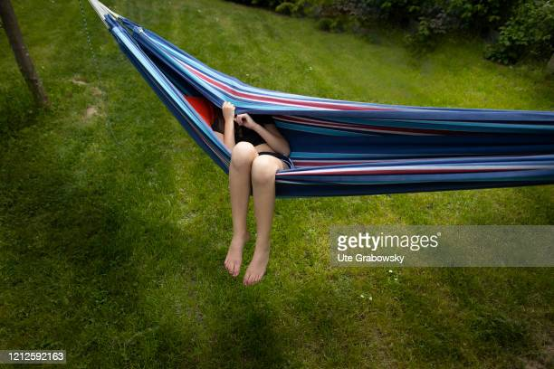 In this photo illustration a girl hides in a hammock on May 09 2020 in Bonn Germany