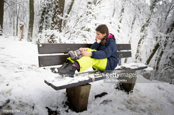 In this photo illustration a girl is frustrated and sitting on a bench on January 09, 2021 in Bonn, Germany.