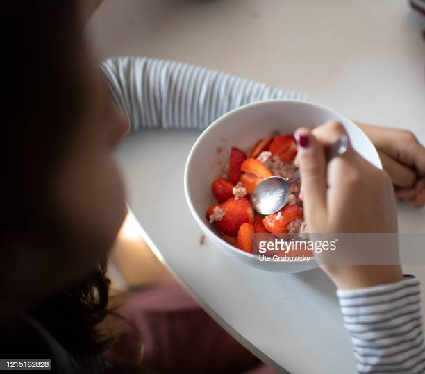 In this photo illustration a girl is having breakfast on May 19 2020 in Bonn Germany