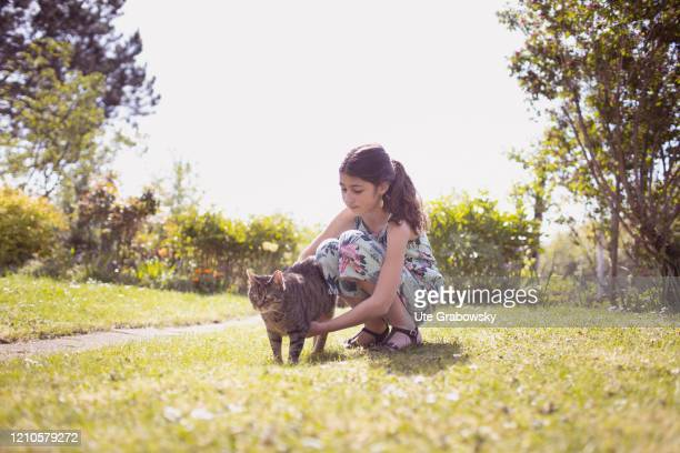 In this photo illustration a girl strokes a cat on April 15 2020 in Bonn Germany