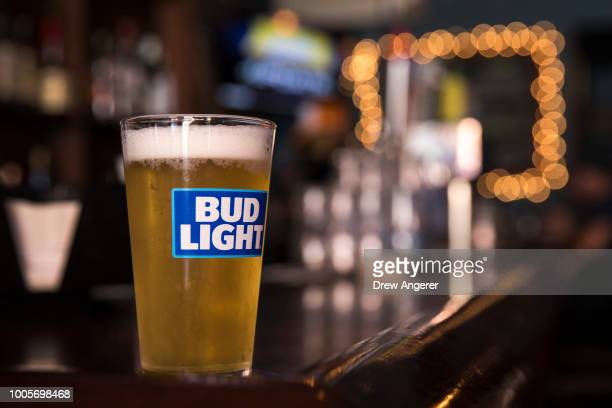 In this photo illustration, a glass of Bud Light sits on a bar, July 26, 2018 in New York City. Anheuser-Busch InBev, the brewer behind Budweiser and...