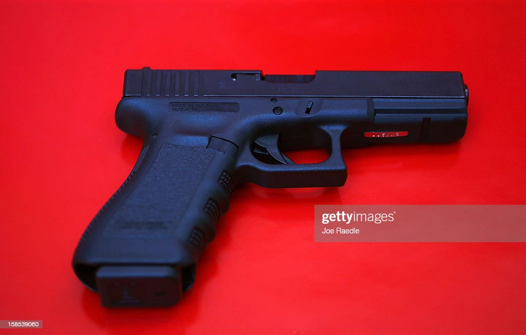 In this photo illustration a Glock pistol is seen on December 18, 2012 in Miami, Florida. The weapon is the same type that was used during a massacre at an elementary school in Newtown, Connecticut. Firearm sales have surged recently as speculation of stricter gun laws and a re-instatement of the assault weapons ban following the mass shooting.