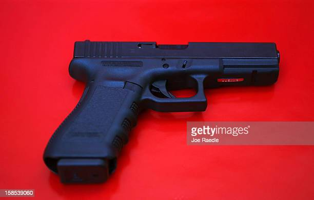 In this photo illustration a Glock pistol is seen on December 18 2012 in Miami Florida The weapon is the same type that was used during a massacre at...