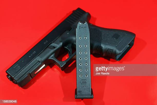 In this photo illustration a Glock pistol with a 17 round magazine is seen on December 18 2012 in Miami Florida The weapon is the same type that was...