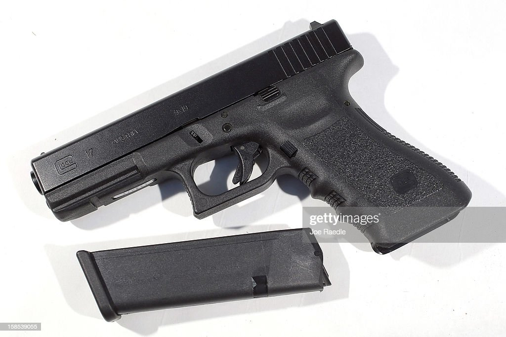 In this photo illustration, a Glock pistol with a 17 round magazine is seen on December 18, 2012 in Miami, Florida. The weapon is the same type that was used during a massacre at an elementary school in Newtown, Connecticut. Firearm sales have surged recently as speculation of stricter gun laws and a re-instatement of the assault weapons ban following the mass shooting.