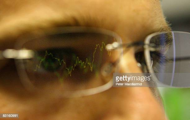 In this photo illustration a graph is reflected representing the 12 month decline of the FTSE 100 share index on October 7 2008 in London Financial...