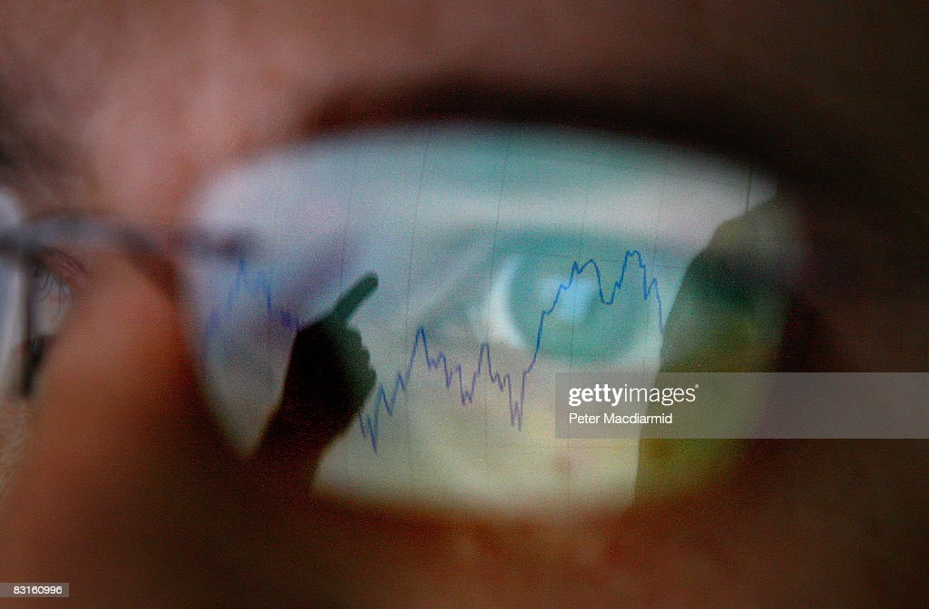 In this photo illustration, a graph is reflected representing the 12 month decline of the FTSE 100 share index on October 7, 2008 in London. Financial markets are still suffering large losses as the global banking crisis continued.