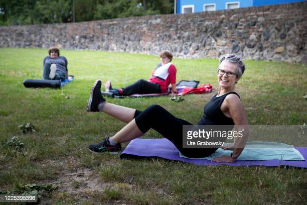 In this photo illustration a gymnastics teacher performs exercises on June 15, 2020 in Bonn, Germany.