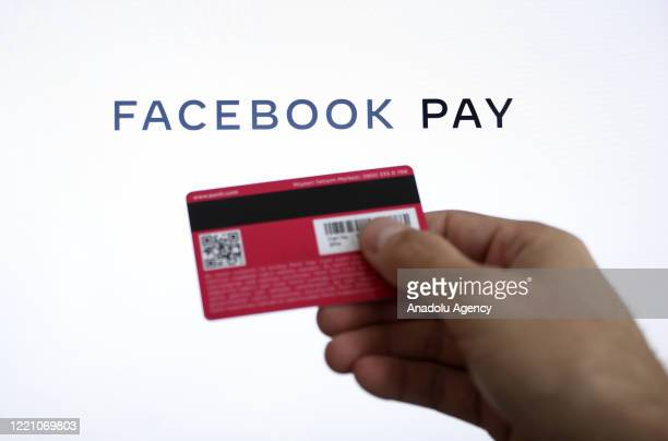 In this photo illustration, a hand holds a credit card in front of screen with Facebook Pay application logo, in Ankara, Turkey on June 18, 2020...