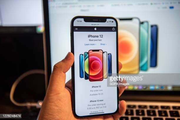 In this photo illustration a hand is holding an iPhone 12 smartphone. IPhone 12 series was released on Oct 13th and began shipping on Oct 23rd.