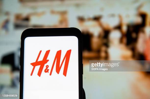 In this photo illustration a HM logo seen displayed on a smartphone