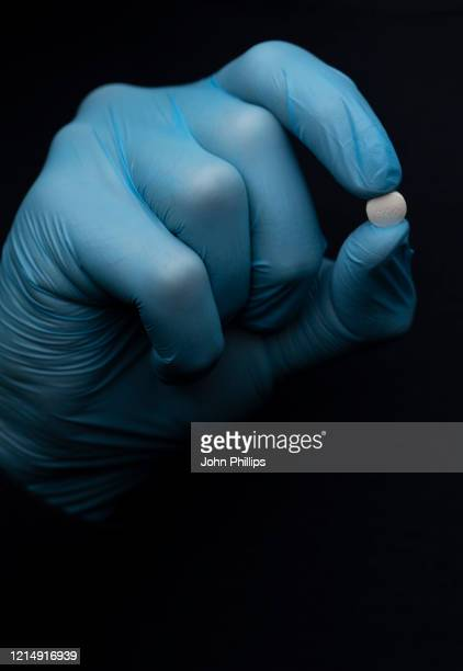 In this photo illustration a Hydroxychloroquine Sulfate medication pill is displayed on March 26, 2020 in London, United Kingdom. The Coronavirus...