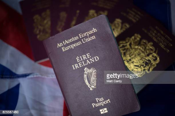 In this photo illustration a Irish passport is seen with United Kingdom passports on August 2 2017 in Wells England Applications for Irish...