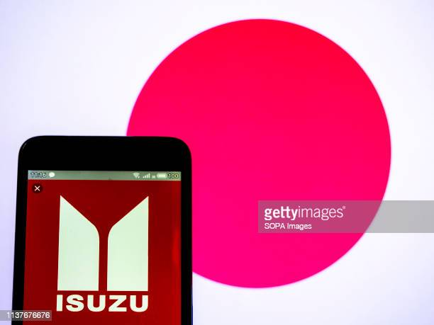In this photo illustration a Isuzu Motors Ltd logo seen displayed on a smart phone