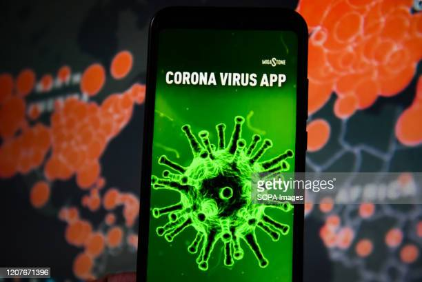 In this photo illustration a Italian Coronavirus app seen displayed on a smartphone with a World map of COVID 19 epidemic on the background.