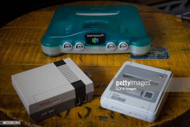 Japanese edition of the Nintendo 64 clear blue version next to a Nintendo Classic Mini 'Nintendo Entertainment System' and a Nintendo Classic Mini...