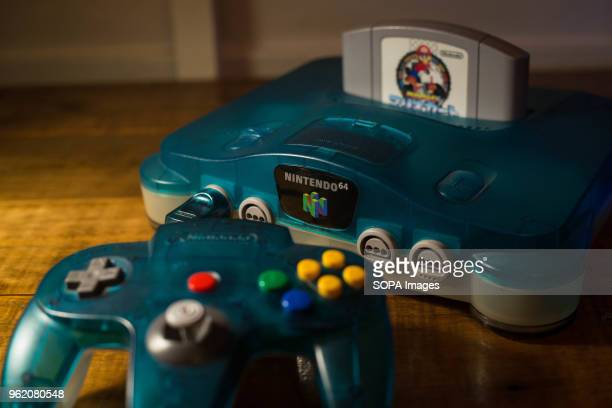 In this photo illustration, a Japanese edition of the Nintendo 64 clear blue version with a cartridge of Mario Kart 64 plugged in. The Nintendo 64...