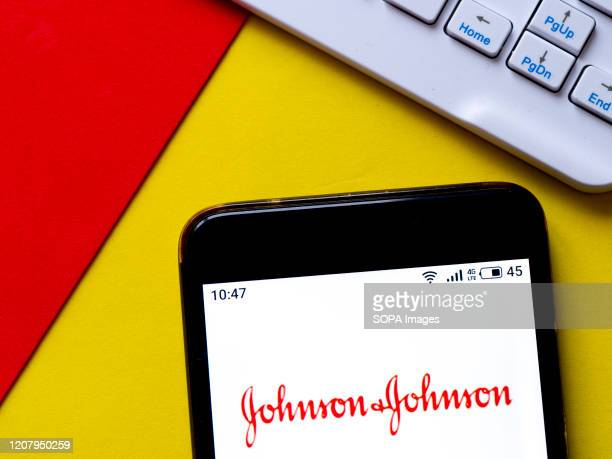 In this photo illustration a Johnson & Johnson logo seen displayed on a smartphone.