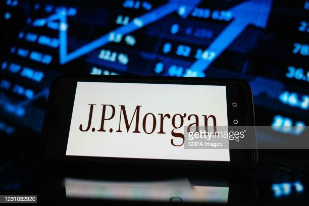In this photo illustration a JP Morgan logo seen displayed on a smartphone screen with stock market graphic on the background.