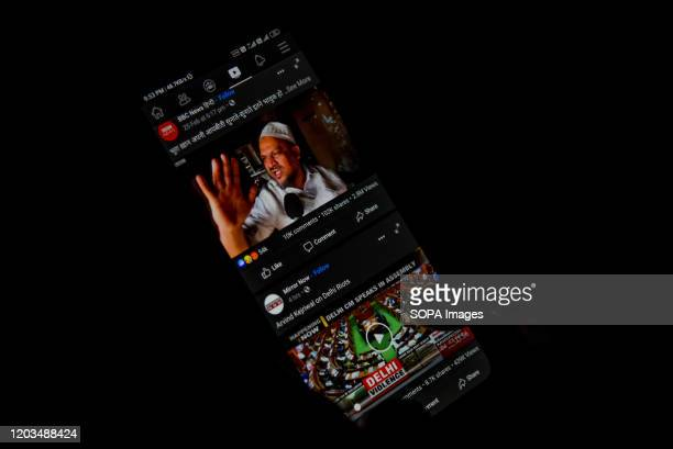 In this photo illustration, a Kashmiri man using social media site, Facebook on his phone with the help of VPN in Srinagar. Authorities in Jammu and...
