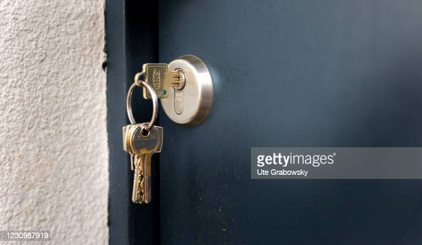 In this photo illustration a key is in the front door from the outside on February 05, 2021 in Bonn, Germany.