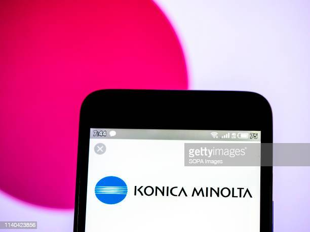 In this photo illustration a Konica Minolta Inc logo seen displayed on a smartphone
