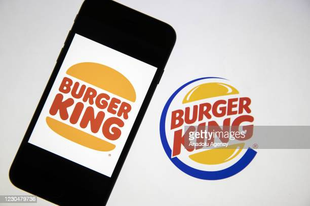 In this photo illustration, a laptop screen displays the new logo of Burger King and a smart phone displays the old logo of it in Ankara, Turkey on...