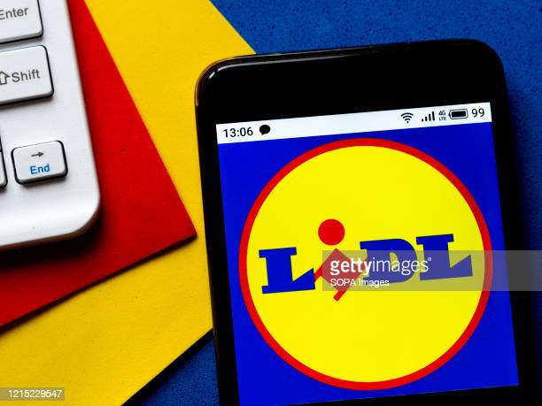 In this photo illustration a Lidl logo seen displayed on a smartphone.