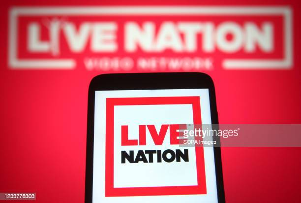 In this photo illustration a Live Nation Entertainment logo is seen on a smartphone and a pc screen.