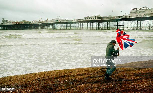 In this photo illustration a lone figure braves the elements, August 27, 2004 on the seafront at Brighton on England's south coast. Traditionally the...