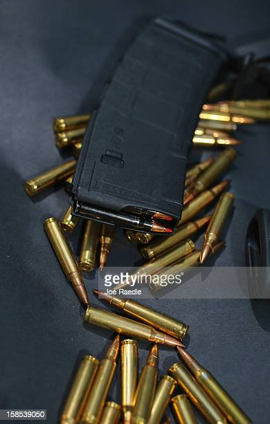 In this photo illustration a magazine for a AR15 rifle is seen with ammunition on December 18 2012 in Miami Florida The AR15 rifle was used during a...