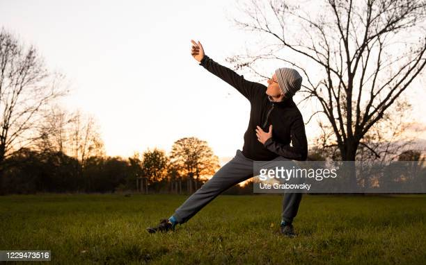 In this photo illustration a man doing Chi Gong exercises on November 04, 2020 in Bonn, Germany.