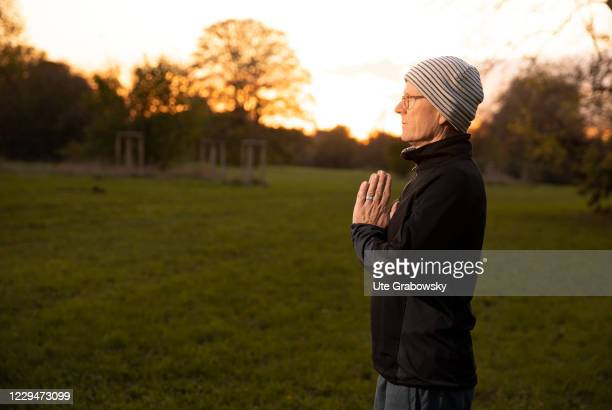 In this photo illustration a man doing yoga exercises on November 04, 2020 in Bonn, Germany.