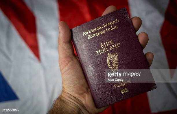 In this photo illustration a man holds a Irish passport on August 2 2017 in Wells England Applications for Irish citizenship from people in the UK...
