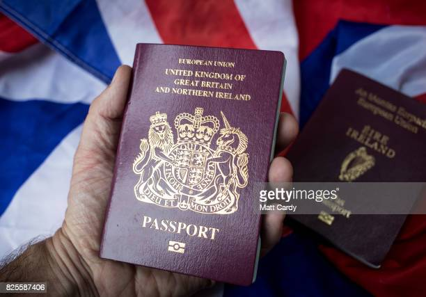 In this photo illustration a man holds a passport of the United Kingdom besides a Irish passport on August 2 2017 in Wells England Applications for...