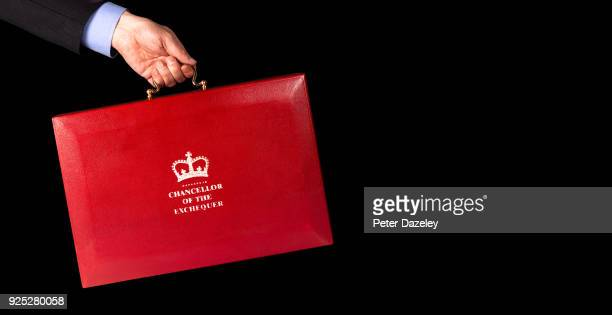 In this photo illustration a Man holds the Chancellor of the Exchequers case budget box held against black background on February 27 2018 in...