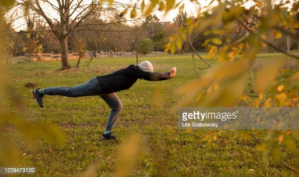 In this photo illustration a man is doing exercises in the fresh air on November 04, 2020 in Bonn, Germany.