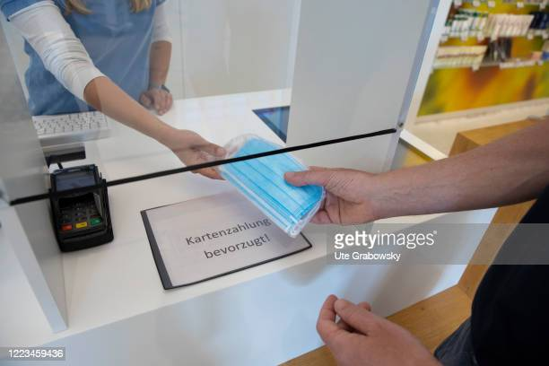 In this photo illustration a man is doing shopping in a pharmacy in times of Corona pandemic on June 12 2020 in Bonn Germany