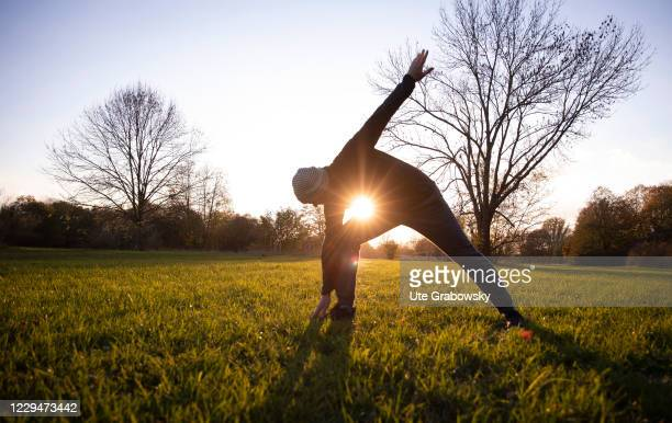 In this photo illustration a man is doing stretches on November 04, 2020 in Bonn, Germany.