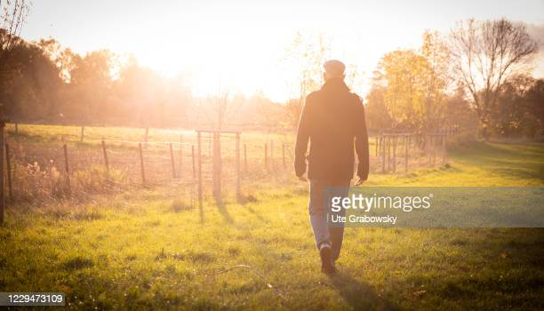 In this photo illustration a man is on an autumn walk on November 04, 2020 in Bonn, Germany.