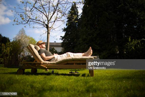 In this photo illustration a man is relaxing on a lounger on April 20, 2021 in Bonn, Germany.